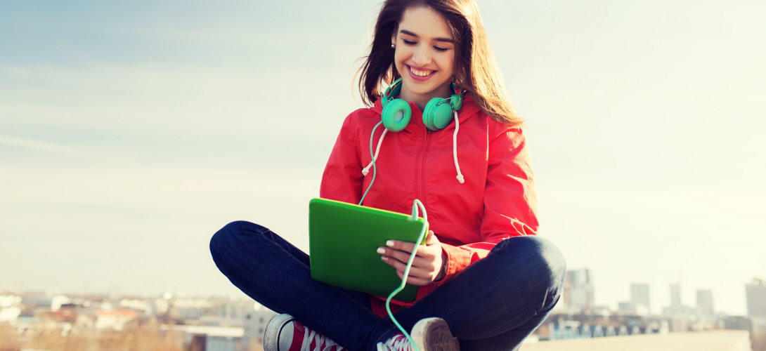 Teen girl watching video on a mobile device.