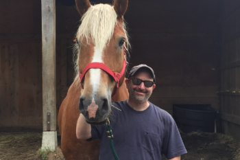 Josh, a rural small business owner, enjoys time with his horse.