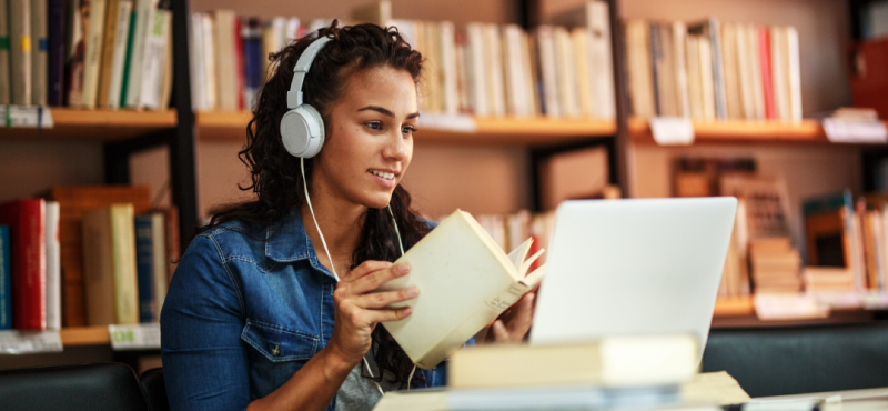 A young female student takes an online course as part of a distance learning degree program.