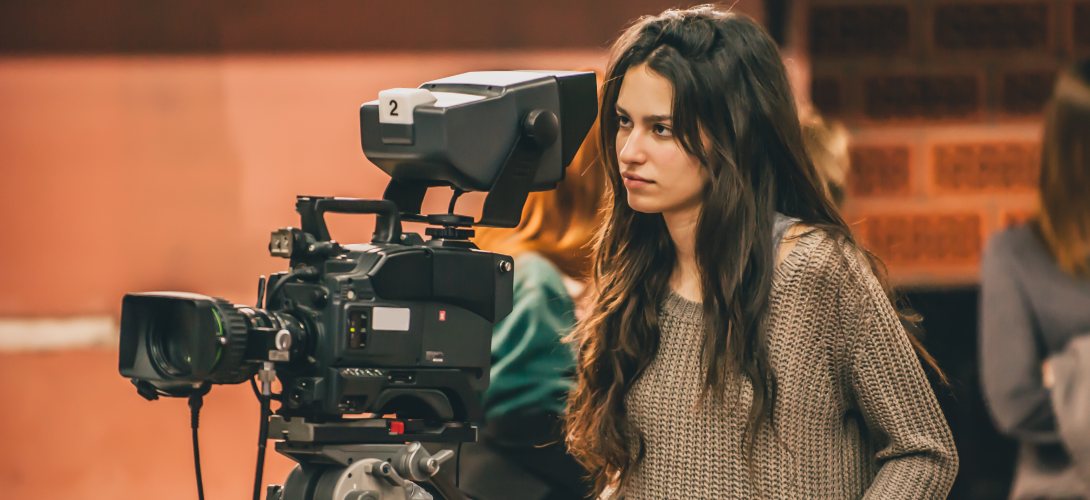Woman operates a television camera.