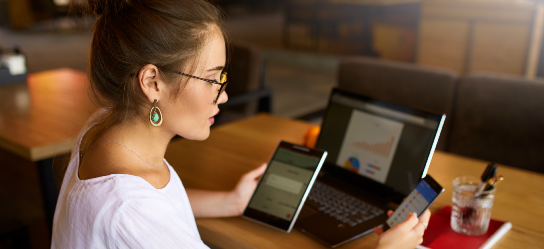 Woman with multiple wi-fi connected devices.