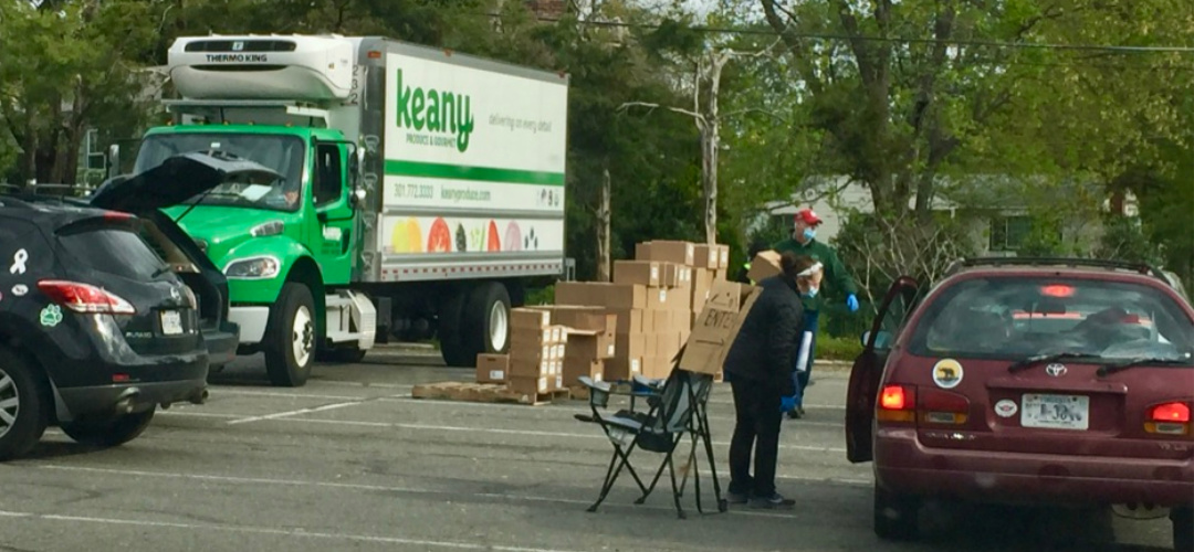 Keany Produce van at a curbside deliver drop point.