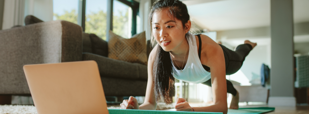 Young woman participates in an online workout.