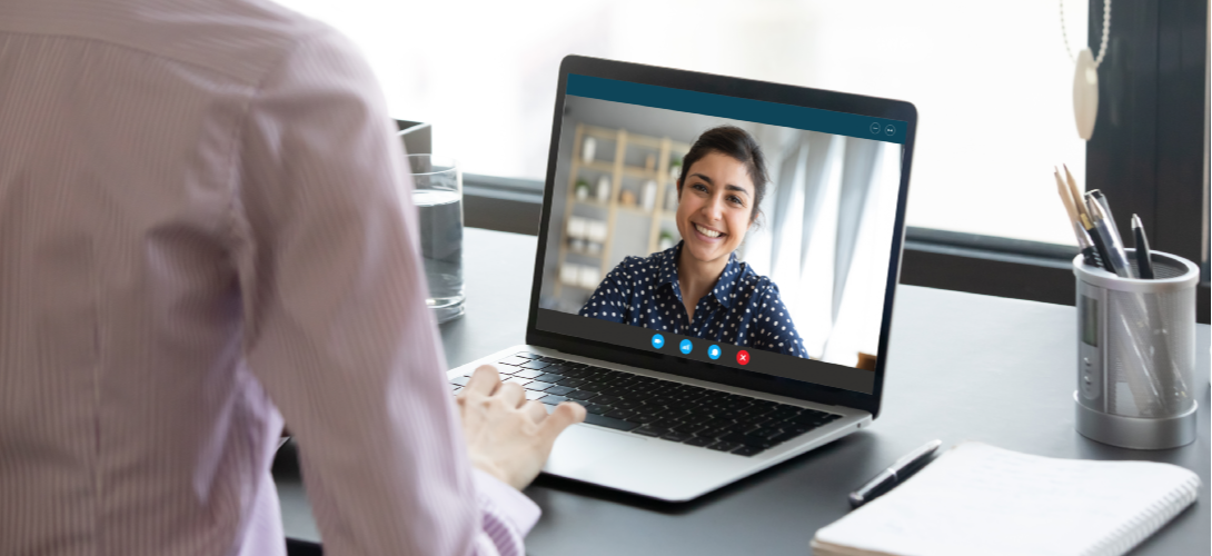 Young woman participates in a virtual therapy session.