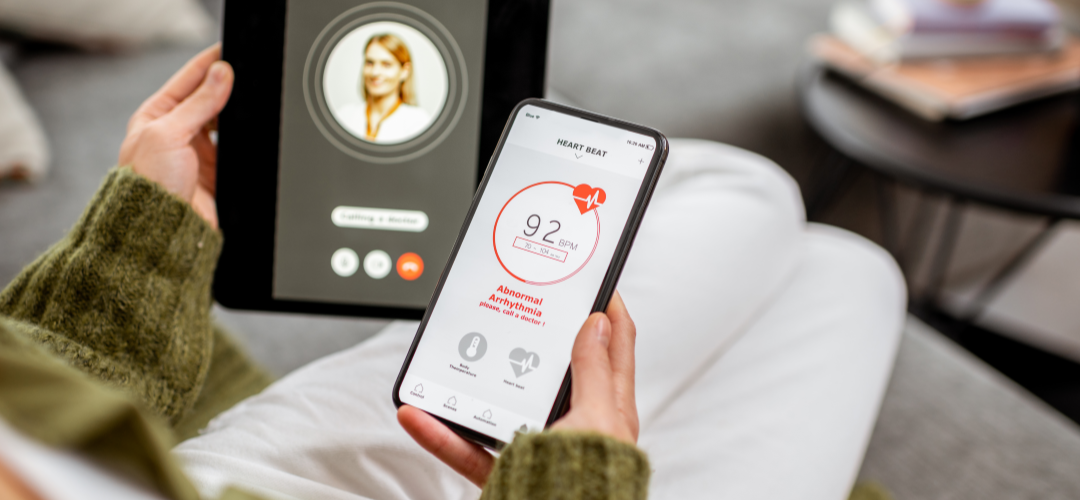 Woman connects personal health data via a telehealth solution.