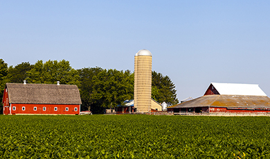 A barn and silo on a farm in a rural area