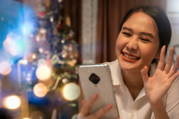 A young girl celebrates New Year's Eve via video chat during COVID-19.